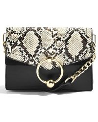 99e021759ab2 Lyst - Topshop Fortune Patch Cross Body Bag in Black