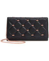 cfd066fbbd9e3d Lyst - Kate Spade Elliott Street Stacy Crystal Bow Leather Wallet in ...