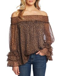 Cece Off-the-shoulder Long Sleeve Ruffle Detail Smocked Leopard Print Volume Blouse - Brown