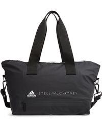 Lyst - adidas By Stella McCartney Shipshape Mesh Gym Bag in Black 1d11b689dc