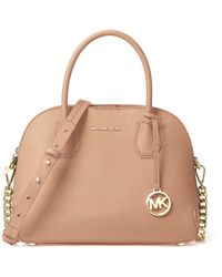 5825d09369953 Lyst - Michael Michael Kors Cindy Large Dome Cross-body Bag in Natural