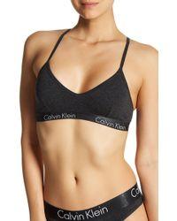 e636c4ced9 Calvin Klein - Motive Racerback Bralette - Lyst