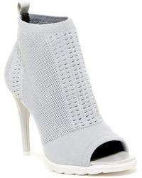 Calvin Klein - Malai Stretch Peep Toe Bootie - Lyst