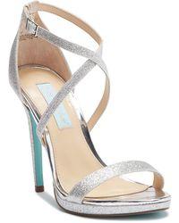 90ec7d5e766 Betsey Johnson Jayce Glitter Block Heel Sandal in Metallic - Lyst