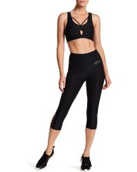 Bebe - Caged Cropped Leggings - Lyst