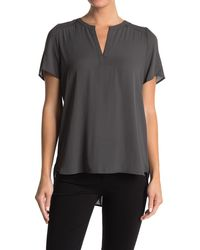 Pleione Solid Pleated Back High/low Tunic Top - Black