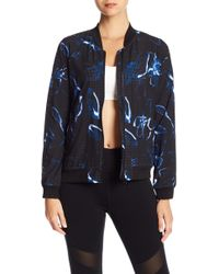 Donna Karan - Perforated Floral Bomber Jacket - Lyst