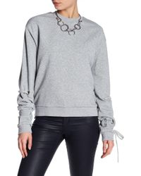 Lucca Couture - Audrey Lu Lace-up Sleeve Sweatshirt - Lyst