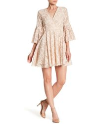Haute Rogue - Bell Sleeve Lace Mini Dress - Lyst