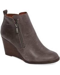 1fa269813276b Lyst - Lucky Brand Women s Pallet Wedge Booties in Brown