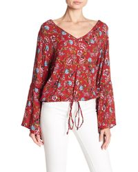 Angie - V-neck Print Bell Sleeve Blouse - Lyst