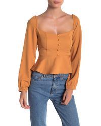 FAVLUX - Peplum Hem Button-down Blouse - Lyst