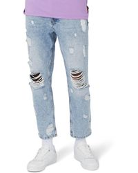 TOPMAN - Topshop Extreme Rip Tapered Jeans - Lyst