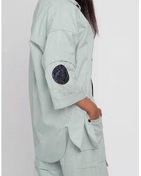 BISKIT Orbit Green Shirt With Circular Space Patch