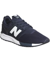new balance 247 trainers in blue