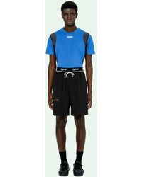 Off-White c/o Virgil Abloh Shorts running con banda logo - Nero
