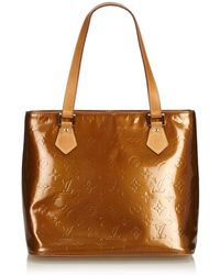 e2c4665b2309 Lyst - Louis Vuitton Ivory Vernis Monogram Alma Gm Handbag in White