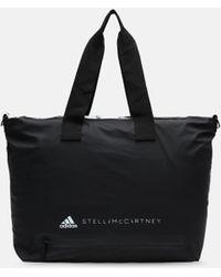 Lyst - adidas By Stella McCartney Small Gym Bag in Black b0a7f865b5