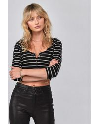 5e6e72291be947 Lyst - Alexis Tess Off-the-shoulder Bell-cuffs Crepe Top in Black