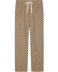 Gucci Pantalones con estampado de monograma - Marrón