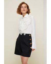 Patou Emblemáticos pantalones cortos de lana - Negro