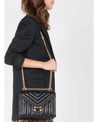 MICHAEL Michael Kors Petit sac convertible Whitney porté épaule en cuir matelassé - Noir