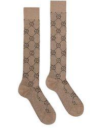 Gucci Chaussettes hautes GG Jacquard en coton - Marron