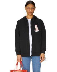 Moschino Sweatshirt avec zip et capuche en coton - Noir