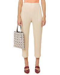 Issey Miyake Pantalon droit en jersey plissé - Neutre
