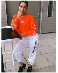 Public Desire Orange Slogan Oversized Crop Sweat Top