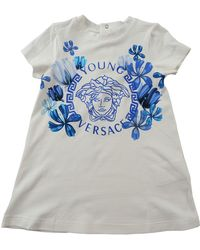 Versace - Baby Dress For Girls On Sale - Lyst