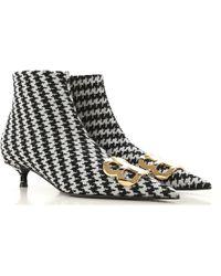 scarpe sportive 99555 f6899 Stivali e Stivaletti Donna In Saldo - Nero