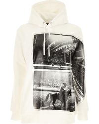 92edd44ab5d5 Sudaderas con capucha Calvin Klein de mujer desde 26 € - Lyst