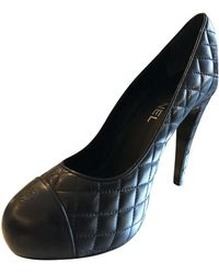 Chanel Pumps/Peeptoes aus Leder - Schwarz