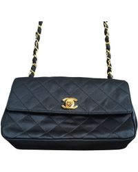 "Chanel ""Classic Flap Bag"" - Schwarz"
