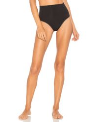 Yummie By Heather Thomson - Seamlessly Shaped Ultralight Nylon Thong - Lyst