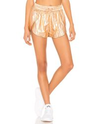Free People - Movement Wind Jammer Short In Metallic Copper - Lyst