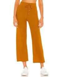 DONNI. Jumper Cropped Flare Sweatpant - Orange