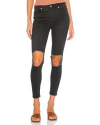 Free People High Rise Busted Skinny Jean. Size 31. - Schwarz