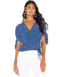 Faithfull The Brand Lucy Ruffled Floral-print Crepe Wrap Top - Blue