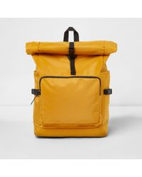 River Island Yellow Roll Top Clip Backpack