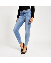 River Island Blue Molly Mid Rise jeggings