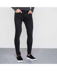 River Island - Ollie Super Skinny Spray On Jeans - Lyst