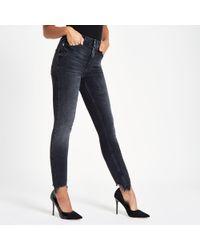 River Island - Harper Super Skinny Ripped Hem Jeans - Lyst