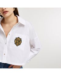 River Island White Batwing Badged Cropped Shirt