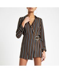 River Island - Navy Stripe Wrap Front Skort Playsuit - Lyst
