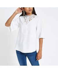 6666bd3ca7a1a River Island White Embellished Bardot Fitted Top in White - Lyst