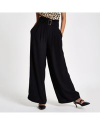 River Island - Black Paperbag Waist Wide Leg Belted Trousers - Lyst