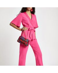 River Island - Pink Tie Front Short Sleeve Jumpsuit - Lyst