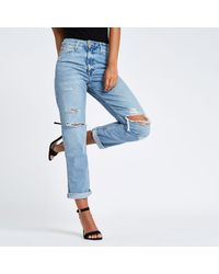 River Island Mid Blue High Rise Mom Fit Ripped Jeans